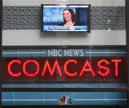 The news ticker outside the Today Show announces GE's sale of NBC to Comcast, in New York, December 3, 2009. REUTERS/Chip East