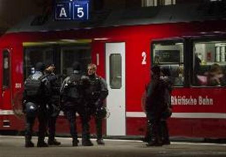 Swiss riot police patrol at the railway station in Landquart after a protest march against the ongoing World Economic Forum in Davos January 29, 2011. REUTERS/Miro Kuzmanovic