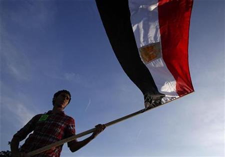 A protester holds an Egyptian flag at a rally against Egypt's President Hosni Mubarak outside the Federal Building in Westwood, California January 29, 2011. REUTERS/Eric Thayer