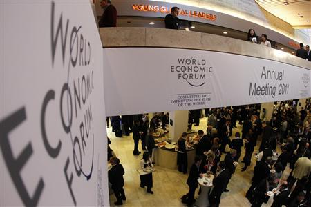 Attendees have lunch at the World Economic Forum (WEF) in Davos, January 29, 2011. REUTERS/Christian Hartmann