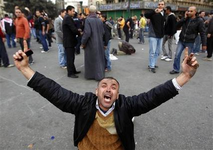 A protester gestures in Tahrir square during an anti-government demonstration in Cairo January 30, 2011. REUTERS/Yannis Behrakis