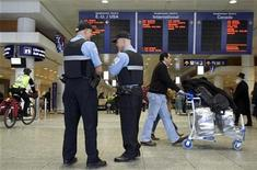 <p>Police officers patrol at Trudeau International Airport in Montreal, January 5, 2010. REUTERS/Christinne Muschi</p>