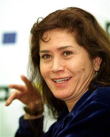 Actress Maria Schneider poses for photographers during Gijon's International Film festival November 25, 2000. REUTERS/STR New