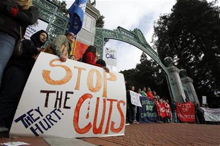 Student protestors hold signs while they block the Sather Gate at the University of California at Berkeley March 4, 2010 to protest against fee increases and budget cuts. REUTERS/Kevin Bartram