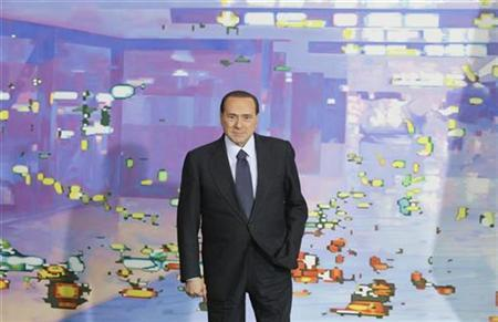 Italian Prime Minister Silvio Berlusconi arrives for a group picture after talks with German Chancellor Angela Merkel in Berlin, January 12, 2011. REUTERS/Tobias Schwarz