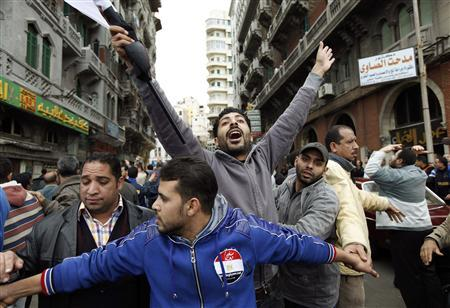 Protesters show their anger as they chant anti-government slogans during mass demonstrations against Egypt's President Hosni Mubarak in Alexandria February 4, 2011. REUTERS/Dylan Martinez