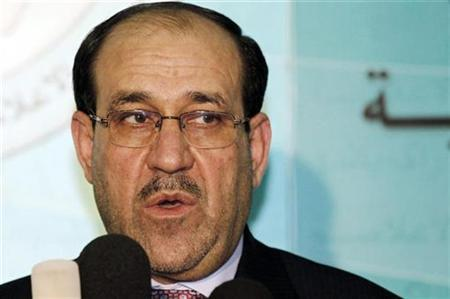 Iraq's Prime Minister Nuri al-Maliki speaks during a joint news conference with Iraqi parliament speaker Osama al-Nujaifi in Baghdad December 20, 2010. REUTERS/Mohammed Ameen