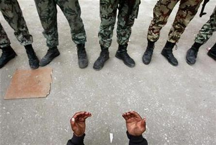 An opposition demonstrator prays in front of army soldiers near Tahrir Square in Cairo February 5, 2011. REUTERS/Yannis Behrakis