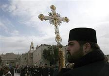 <p>A clergy member waits ahead of the Armenian Christmas procession in Manger square outside the Church of the Nativity in the West Bank town of Bethlehem January 18, 2011. REUTERS/Darren Whiteside</p>