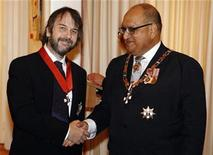 <p>Director Peter Jackson (L) of New Zealand shakes hands with New Zealand's Governor-General Anand Satyanand after being knighted by Satyanand at Premier House in Wellington April 28, 2010. REUTERS/Dominion Post/ Kent Blechynden/Pool</p>