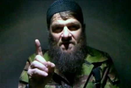 Islamist rebel leader Doku Umarov gestures in this still image taken from undated video footage. Umarov said on February 7, 2011 he had ordered a suicide bombing that killed 36 people at Russia's busiest airport last month. Umarov, 46, speaking in a video carried by the Islamist website www.kavkazcenter.com, said there would be further such attacks in pursuit of an independent Muslim state governed by Sharia law in Russia's Caucasus region -- a territory embracing Chechnya, Dagestan and other nearby territories. Umarov appeared in the video, apparently made on the day of the Jan. 24 attack on Moscow's Domodedovo airport, wearing combat fatigues, talking quietly and hesitantly. REUTERS/www.kavkazcenter.com