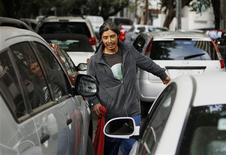 "<p>Carmelo Morales, 36, known as a ""franelero""or ""rag boy"", works to park cars on the streets in the Condesa neighborhood in Mexico City February 3, 2011. REUTERS/Henry Romero</p>"