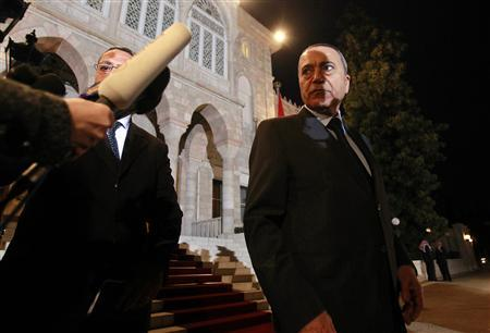 Jordanian Prime Minister Maruf Bakhit speaks to the media after their swearing-in ceremony at Raghadan Palace in Amman February 9, 2011. REUTERS/Muhammad Hamed