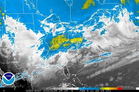 Storm systems are seen in a satellite photo taken February 9, 2011. REUTERS/NOAA/Handout