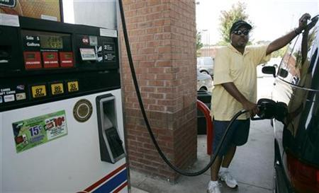 Daryl Batey fills his gas tank at a Kroger fuel station after waiting in line due to gasoline shortages in the state in Stone Mountain, Georgia, September 29, 2008. REUTERS/Tami Chappell