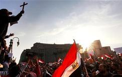<p>Сторонники оппозиции на площади Тахрир в Каире 9 февраля 2011 года. Египетские власти не прекращают сопротивляться растущему давлению со стороны своего ключевого партнера, США, и собственного населения, требующих радикальных и немедленных политических перемен. REUTERS/Yannis Behrakis</p>
