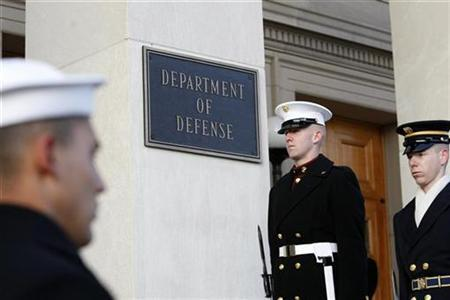 Honor guards stand at attention on the steps of the Pentagon, December 3, 2010. REUTERS/Hyungwon Kang