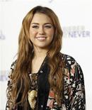 """<p>La cantante y actriz Miley Cyrus durante el estreno del filme """"Justin Bieber: Never Say Never"""" en el teatro Nokia en Los Angeles, feb 8 2011. En diciembre del 2010, la imagen de Miley Cyrus fumando en una pipa de agua fue vista en todo el mundo. REUTERS/Mario Anzuoni</p>"""
