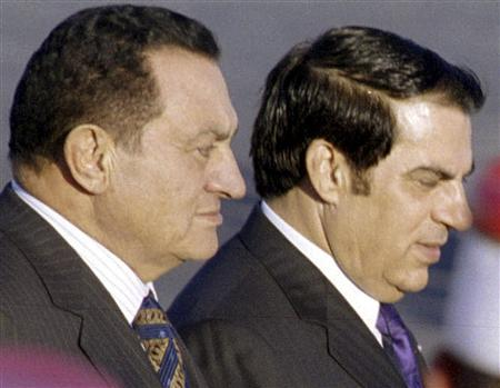 Egyptian President Hosni Mubarak (L) is escorted by Tunisian President Zine al-Abidine Ben Ali upon his arrival in Tunis in this October 30, 2002 file photo. REUTERS/Mohamed Hammi/Files
