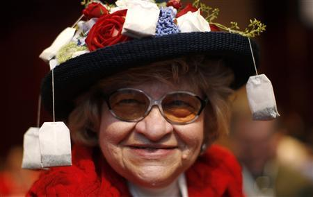 With tea bags hanging from her hat, Tea Party member Martha Stamp of Wakefield, Rhode Island, attends the 38th annual Conservative Political Action Conference (CPAC) in Washington February 10, 2011. REUTERS/Kevin Lamarque
