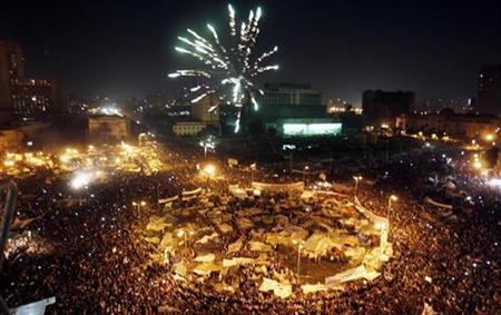 Thousands of Egyptian anti-government protesters celebrate inside Tahrir Square after the announcement of Egyptian President Hosni Mubarak's resignation in Cairo February 11, 2011. REUTERS/Amr Abdallah Dalsh