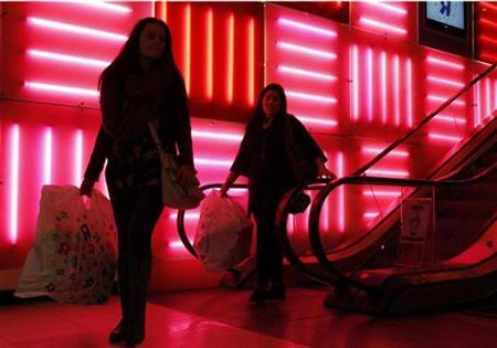 Shoppers depart with their bags at Toys R Us on Black Friday in New York November 26, 2010. REUTERS/Jessica Rinaldi