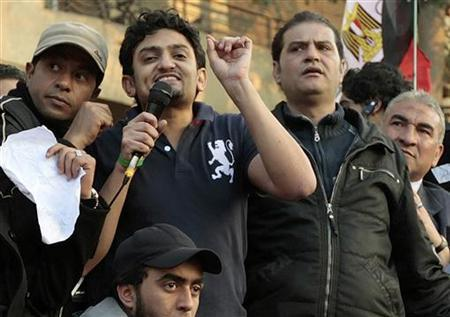 Google Inc executive Wael Ghonim (2nd L) addresses a mass crowd inside Tahrir Square in Cairo February 8, 2011. REUTERS/Dylan Martinez