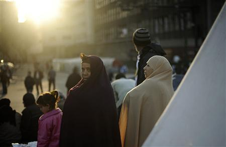 The sun rises on anti-government protesters as they wake inside Tahrir Square in Cairo February 12, 2011. REUTERS/Dylan Martinez