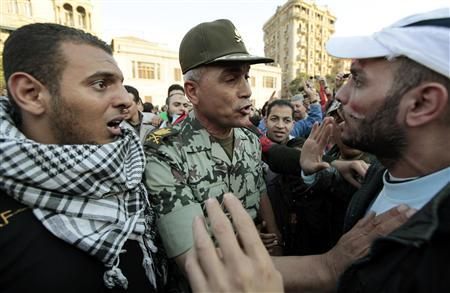 An Egyptian army officer reassures a worried anti-government protestor as he walks through Tahrir Square in Cairo February 12, 2011. REUTERS/Dylan Martinez