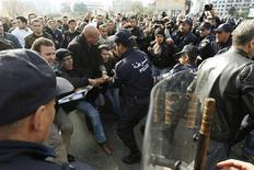 <p>Algerian policemen try to take away a banner from anti-government protesters during a demonstration in Algiers February 12, 2011. REUTERS/Zohra Bensemra</p>