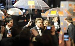 <p>Actor Colin Firth arrives to attend the British Film and Television Arts (BAFTA) award ceremony at the Royal Opera House in London February 13, 2011. REUTERS/Paul Hackett</p>