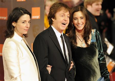 Singer Paul McCartney (C) arrives to attend the British Academy of Film and Television Arts (BAFTA) award ceremony at the Royal Opera House in London February 13, 2011. REUTERS/Paul Hackett