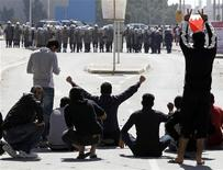 <p>Bahrain youths demonstrate in front of the police in Manama, February 14, 2011. S REUTERS/Hamad I Mohammed</p>