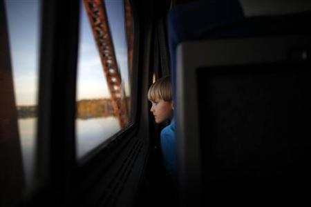 A boy watches through a window of an Amtrak train from Birmingham to Anniston, Alabama November 14, 2009. REUTERS/Carlos Barria