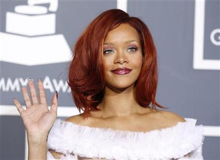 Singer Rihanna poses in an outfit designed by Jean Paul Gaultier upon arrival at the 53rd annual Grammy Awards in Los Angeles, California February 13, 2011. REUTERS/Danny Moloshok