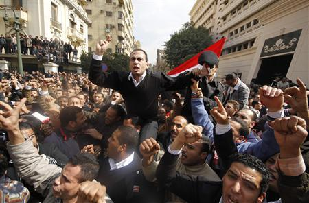 Egyptian policemen take part in a protest demanding for higher wages in front of the Interior Ministry in Cairo February 14, 2011. Note: The blurred spots in the picture were caused by water on the camera lens. REUTERS/Mohamed Abd El-Ghany