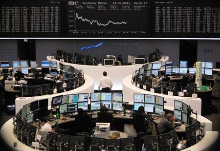 Traders are pictured at their desks in front of the DAX board at the Frankfurt stock exchange February 14, 2011. REUTERS/Remote/Amanda Andersen
