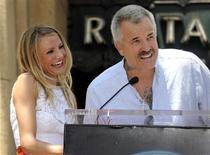 <p>Director Nick Cassavetes (R) speaks at a ceremony where actress Cameron Diaz (L) receives a star on the Hollywood Walk of Fame in Los Angeles June 22, 2009. REUTERS/Phil McCarten</p>