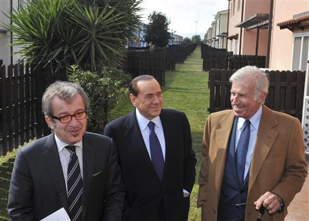 Italian Prime Minister Silvio Berlusconi (C) and Interior Minister Roberto Maroni (L), accompanied by an unidentified man, visit a property to be possibly used as an immigration holding center, in Mineo near Catania, south Italy February 15, 2011. REUTERS/Italy's Prime Minister's office/Livio Anticoli/Handout