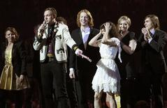 <p>Members of Canadian band Arcade Fire react after winning the International album trophy during the BRIT music awards at the O2 Arena in London February 15, 2011. REUTERS/Luke Macgregor</p>