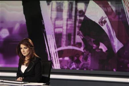 News anchor Rola Ibrahim is seen in the studio of the Arabic Al Jazeera satellite news channel in Doha February 7, 2011. REUTERS/ Fadi Al-Assaad