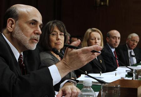 Chairman of the Federal Reserve Ben Bernanke (L) speaks as Chairman of the Federal Deposit Insurance Corporation Sheila Bair (2nd L), Chairman of the Securities and Exchange Commission Mary Schapiro (C), Chairman of the Commodity Futures Trading Commission Gary Gensler (2nd R) and acting Comptroller of the Currency John Walsh (R) listen, at the Senate Banking Committee on Capitol Hill in Washington February 17, 2011. REUTERS/Larry Downing