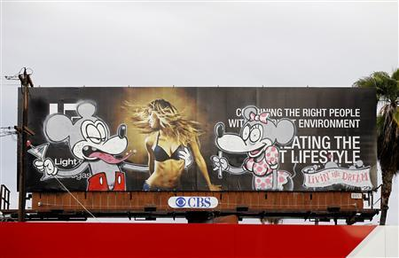 Artwork painted on a billboard in Los Angeles, February 16, 2011. Several examples of graffiti bearing the hallmarks of Banksy's style and humor have turned up in areas of the city in recent days, including a Charlie Brown figure apparently bent on arson, and a cocktail-swigging Mickey Mouse. REUTERS/Mario Anzuoni
