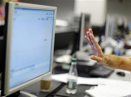 An man gestures before a computer screen in a file photo. REUTERS/Brian Snyder