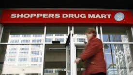 <p>A pedestrian walks past a Shoppers Drug Mart in Ottawa November 10, 2010. REUTERS/Chris Wattie</p>