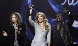 """<p>Steven Tyler, Jennifer Lopez and Randy Jackson (L-R) stand together after being announced as the judges for the 10th season of the television show """"American Idol"""" at the Forum in Inglewood, California September 22, 2010. REUTERS/Mario Anzuoni</p>"""