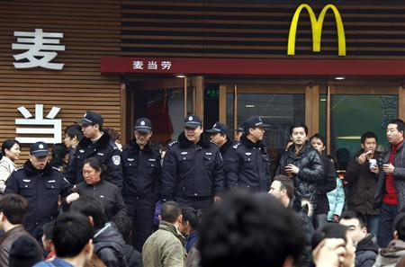 Policemen push away members of the public out the front of a Mcdonalds store after internet social networks called to join a ''Jasmine Revolution'' protest in central Beijing February 20, 2011. Chinese President Hu Jintao called on Saturday for stricter government management of the Internet while calls for gatherings inspired by uprisings in the Middle East spread on Chinese websites abroad. The messages have scant chance of inspiring protests in China whose one-party government has plenty of censorship controls in place and where most Chinese have difficulty gaining access to overseas websites because of a censorship ''fire wall.'' REUTERS/David Gray