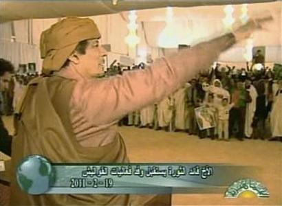 Still image from a video footage shows Libya's leader Muammar al Gaddafi gesturing to his supporters during a rally in Nalut February 19, 2011. REUTERS/Libyan TV via Reuters TV NO SALES. NO ARCHIVES. FOR EDITORIAL USE ONLY. NOT FOR SALE FOR MARKETING OR ADVERTISING CAMPAIGNS. LIBYA OUT. NO COMMERCIAL OR EDITORIAL SALES IN LIBYA