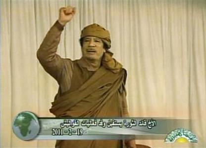 Still image from a video footage shows Libya's leader Muammar al Gaddafi gesturing to his supporters during a rally in Nalut February 19, 2011. REUTERS/Libyan TV via Reuters TV