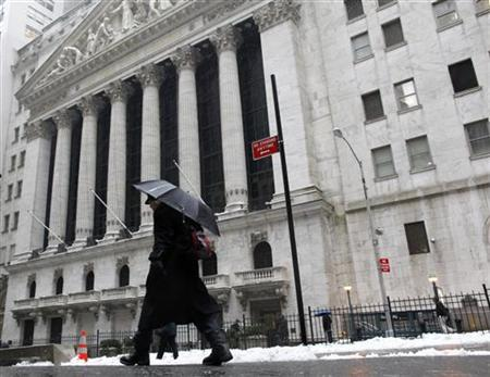 A man walks past the New York Stock Exchange in New York during the morning commute, January 18, 2011. REUTERS/Brendan McDermid